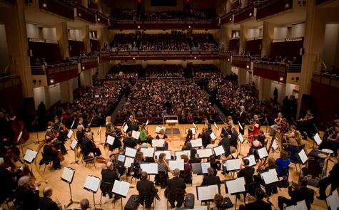 Photo of North Carolina Symphony and audience from the stage perspective
