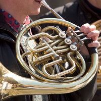 close up photo of a french horn player