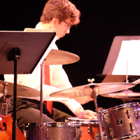 Photo of drum set player during jazz lab concert