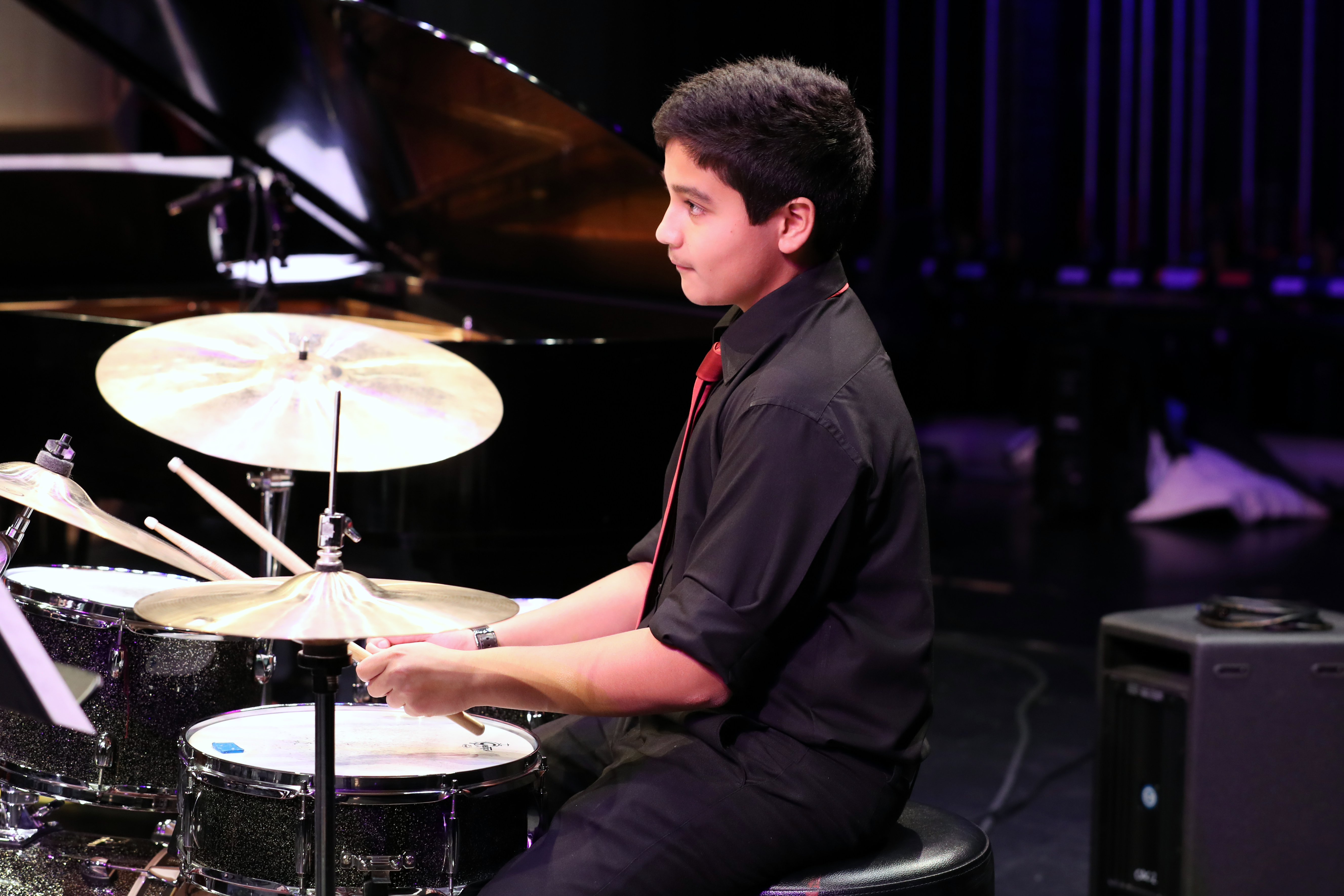 photo of jazz band drummer in action