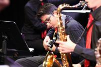 Photo of jazz band saxophonist and guitarist in action