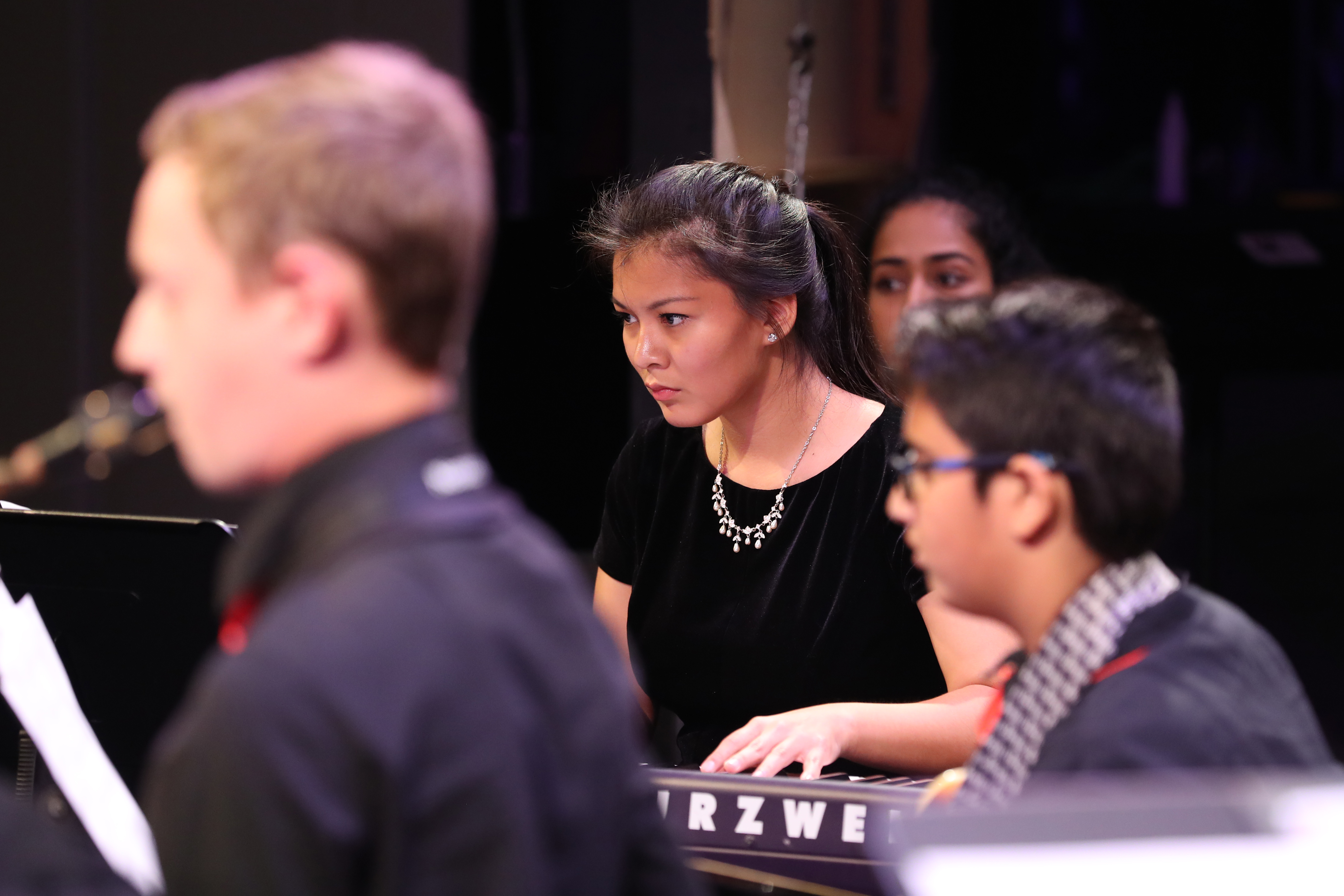 Photo of jazz band keyboardist in action