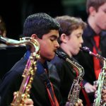 Photo of jazz band saxophone section in action