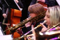 Close up photo of two jazz band trombonists in action