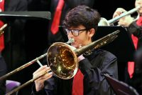 Close up photo of jazz band trombonist in action