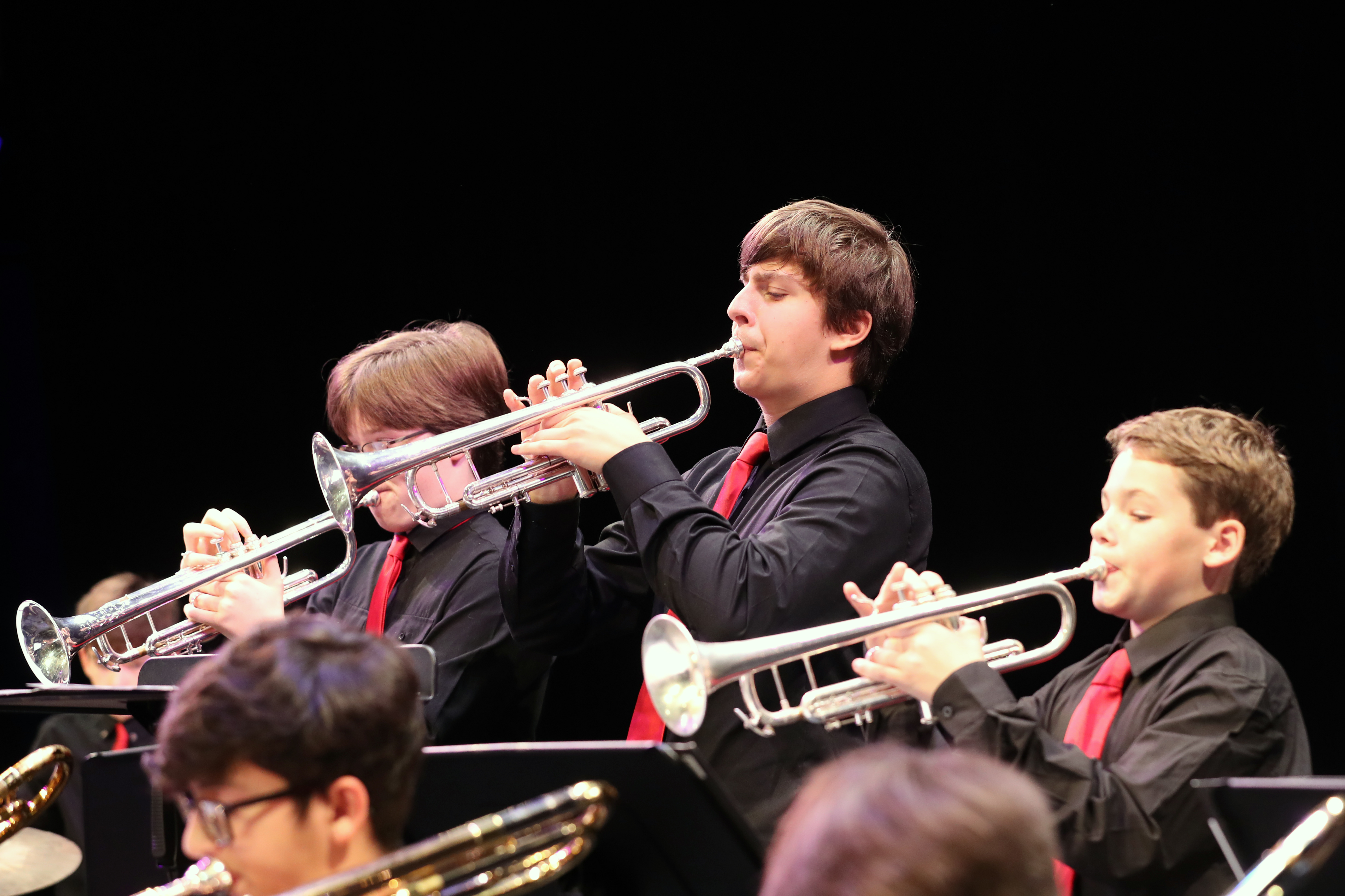 Photo of jazz band trumpet section in action