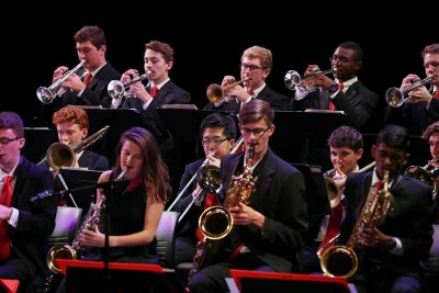 Photo of jazz ensemble horn section during a concert