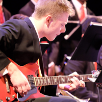 Photo of guitarist at jazz ensemble concert