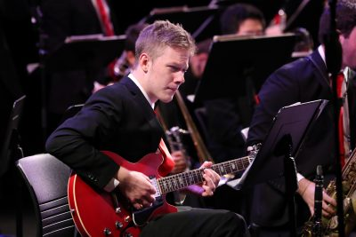 Photo of jazz ensemble guitarist during a concert