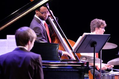 Photo of jazz ensemble rhythm section during a concert