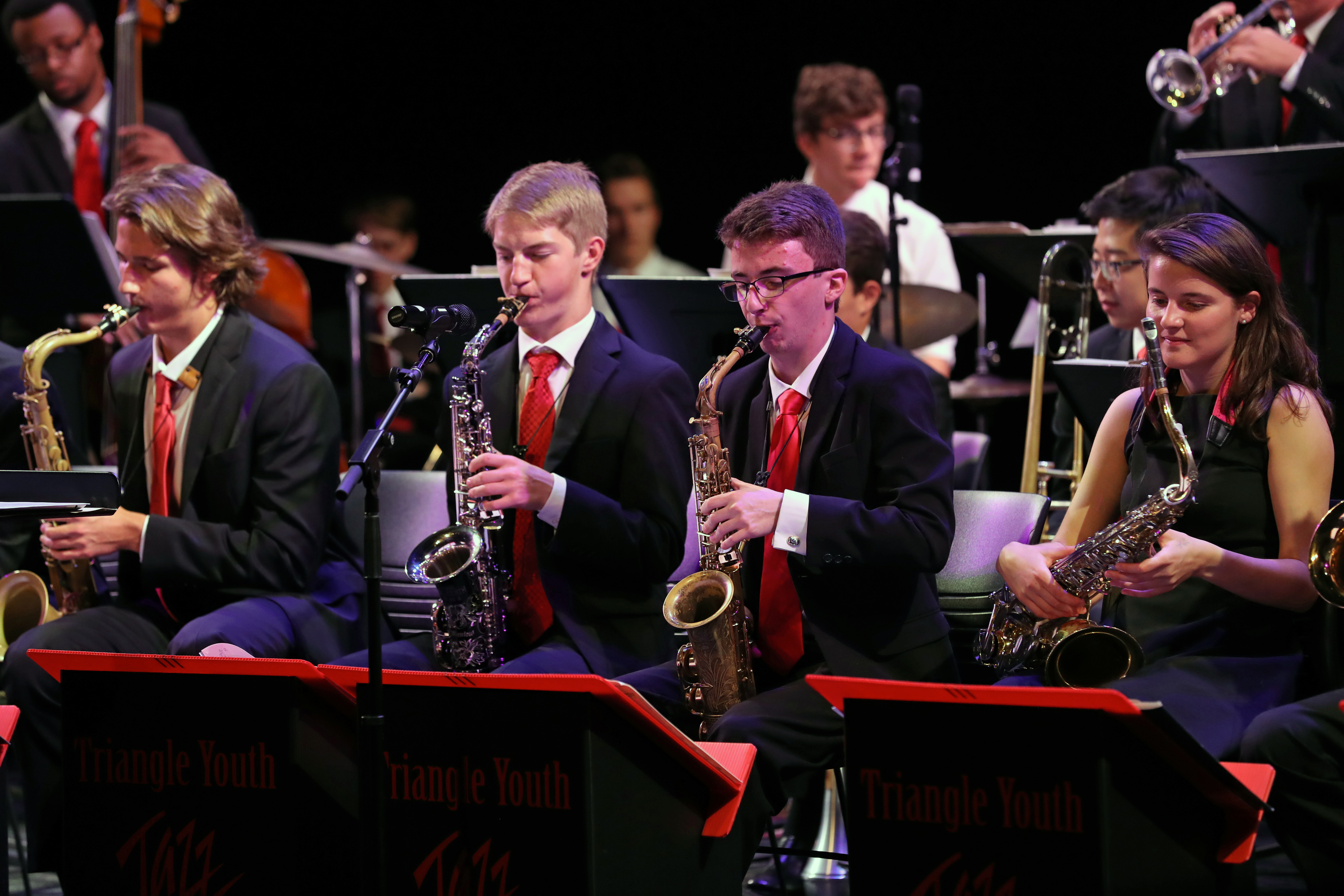 Photo of jazz ensemble saxophone section during a performance