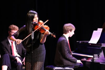 photo of guest violin soloist at jazz ensemble concert
