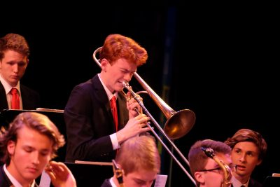 photo of jazz ensemble trombonist taking a solo