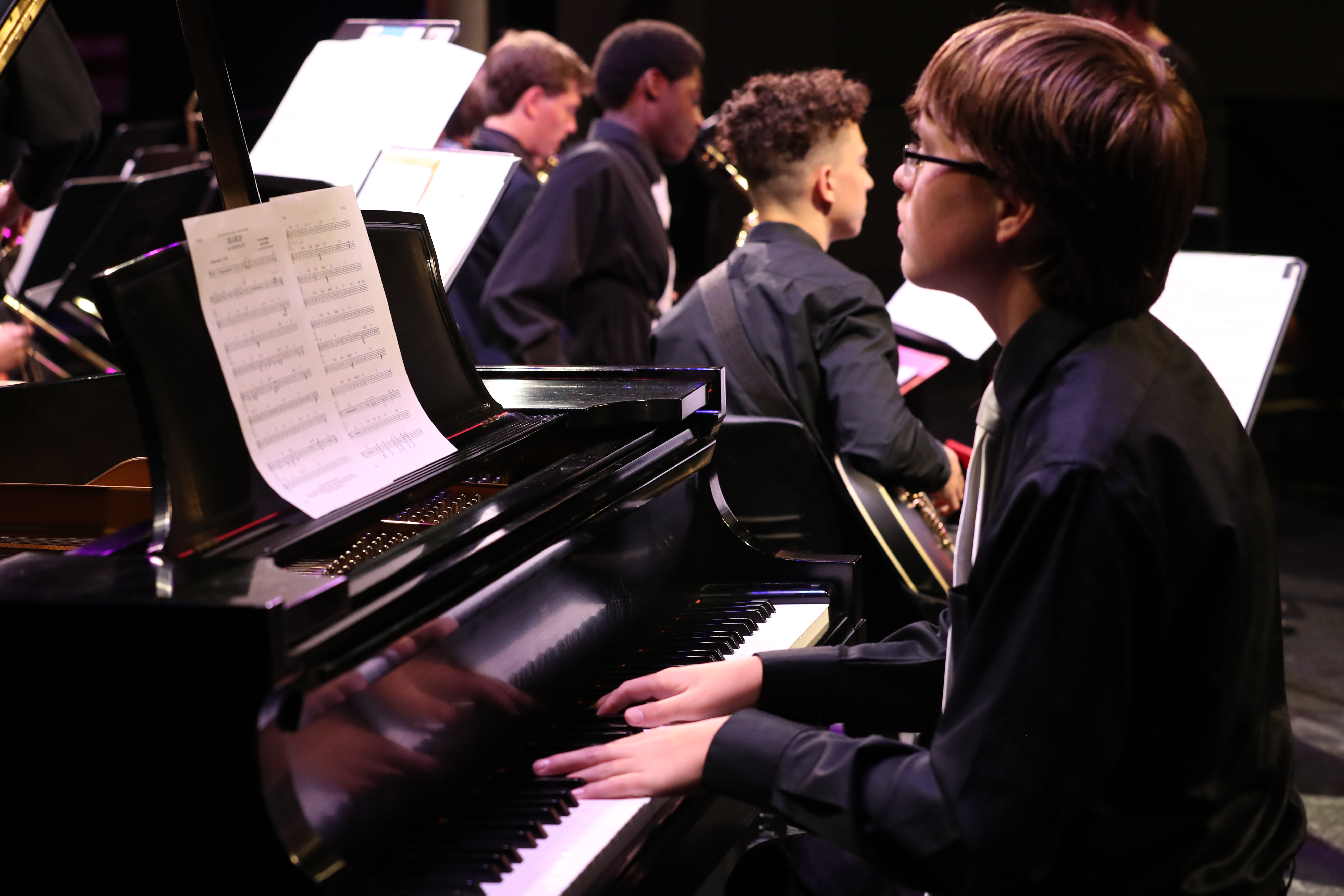 close up photo of jazz orchestra pianist during concert
