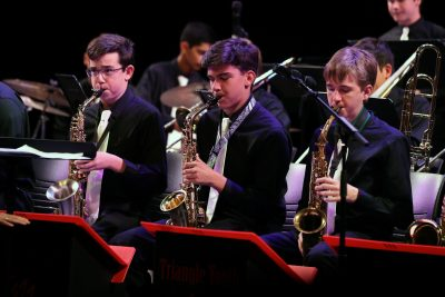 photo of three jazz orchestra saxophonists during a concert