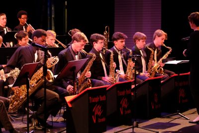 photo of jazz orchestra saxophone section during performance