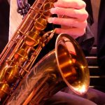 close up photo of a saxophone during a jazz orchestra concert