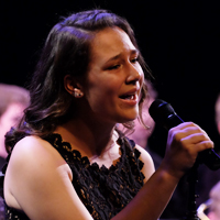Photo of singer at jazz orchestra concert
