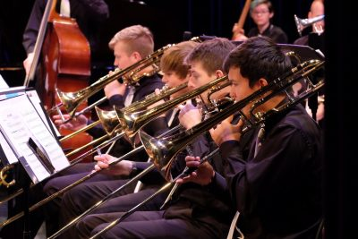 photo of jazz orchestra trombone section during performance