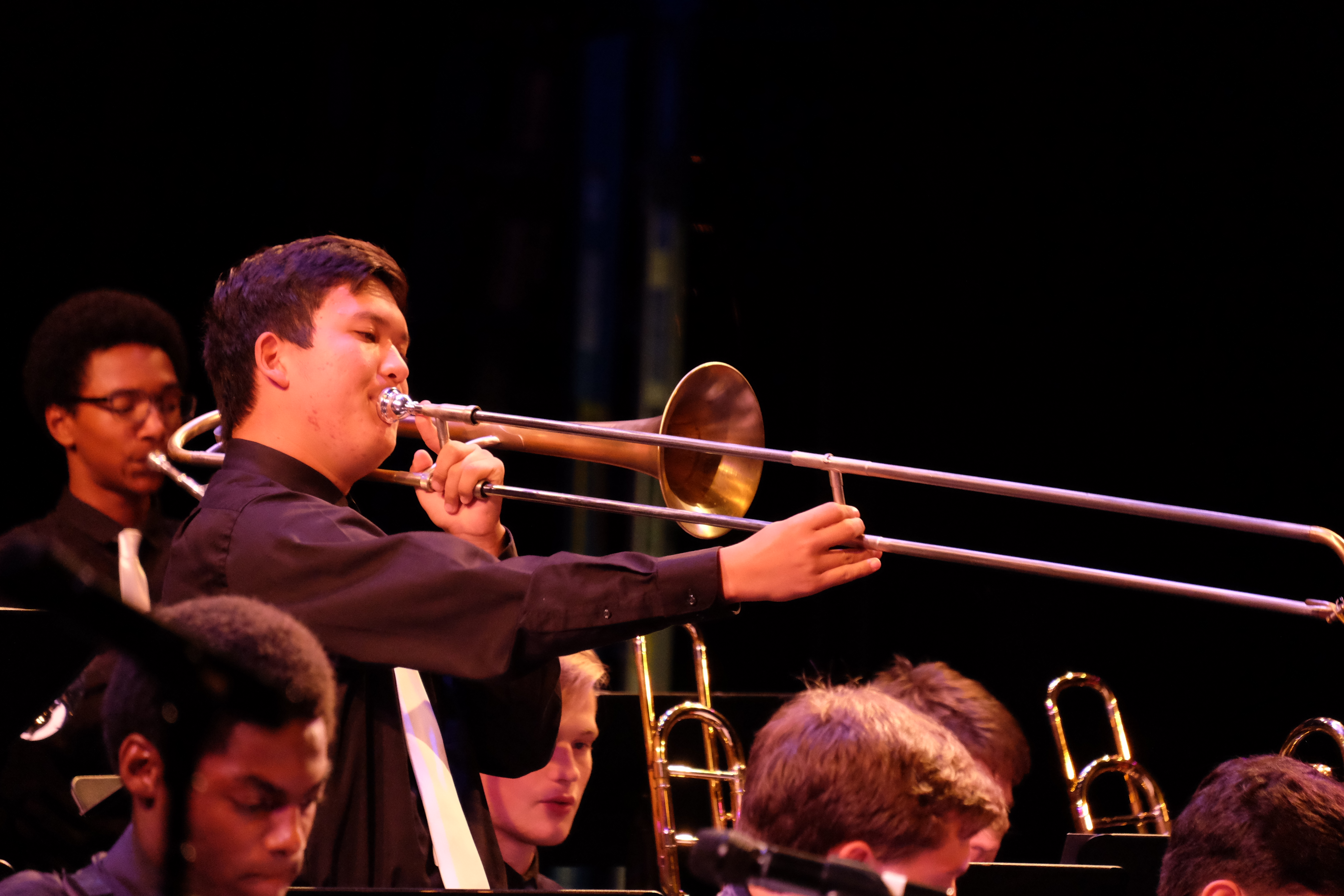 photo of jazz orchestra trombonist taking a solo