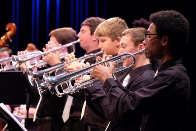photo of jazz orchestra trumpet section during performance
