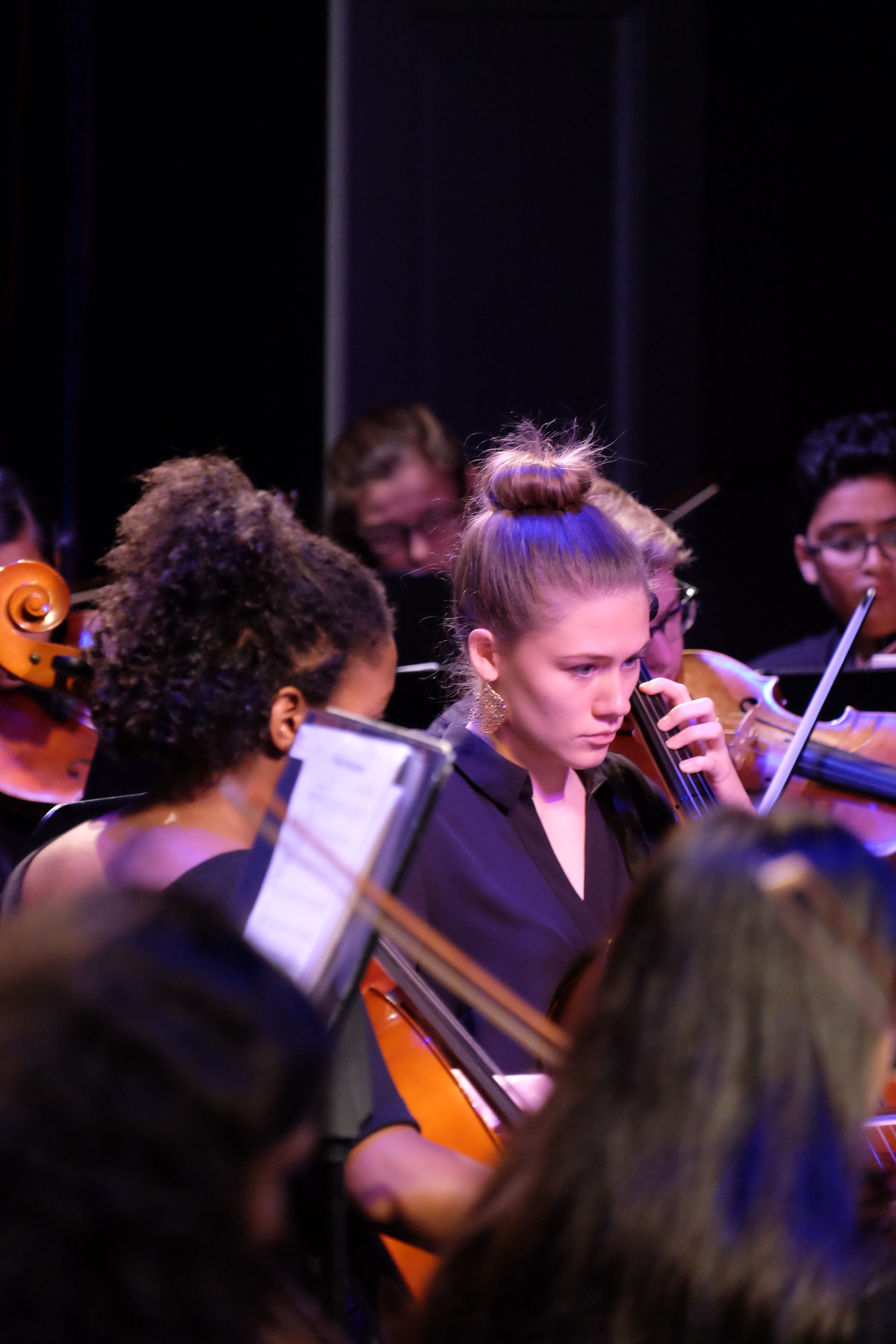 photo of string sinfonia cellists during a concert