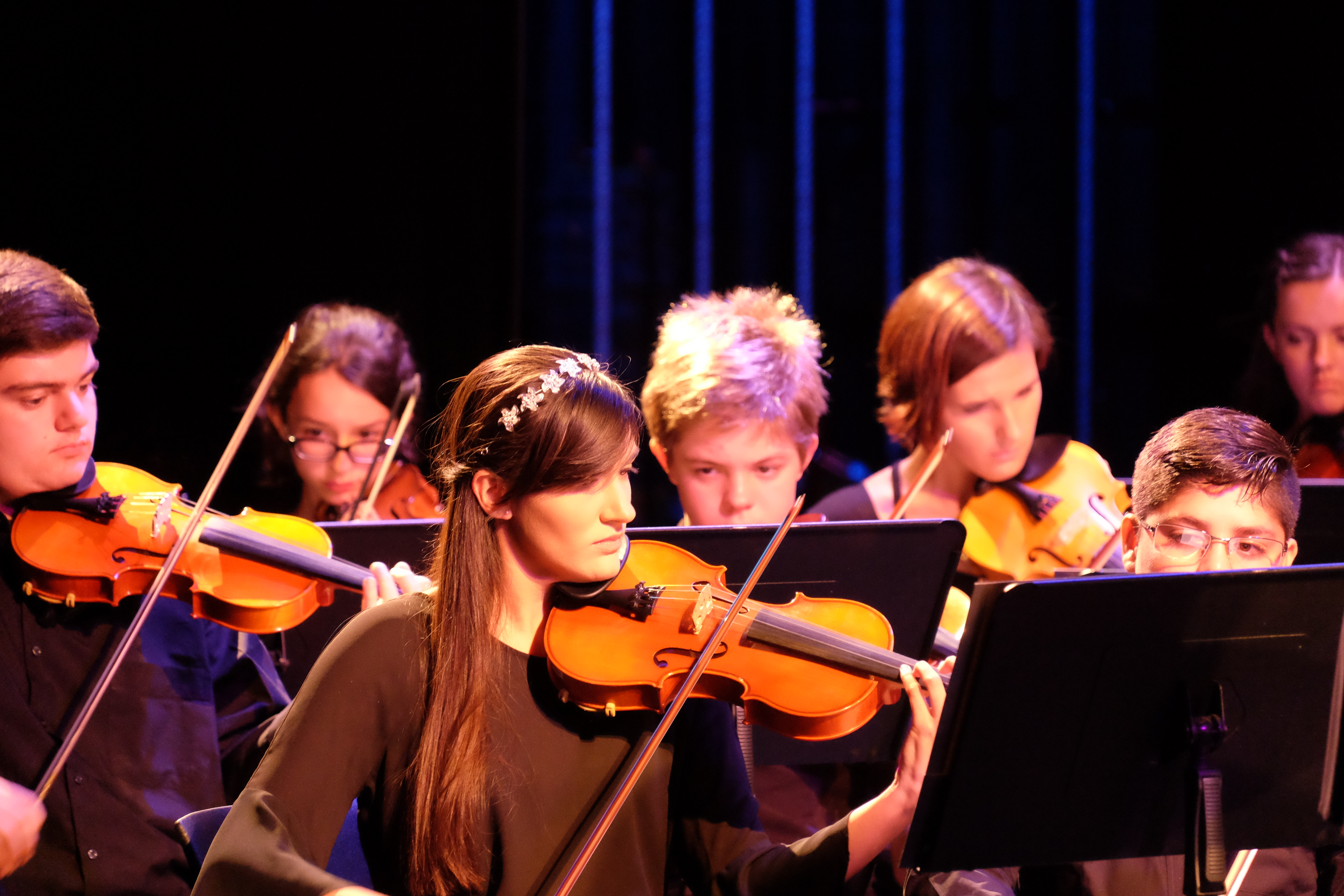 photo of string sinfonia violinists during a performance