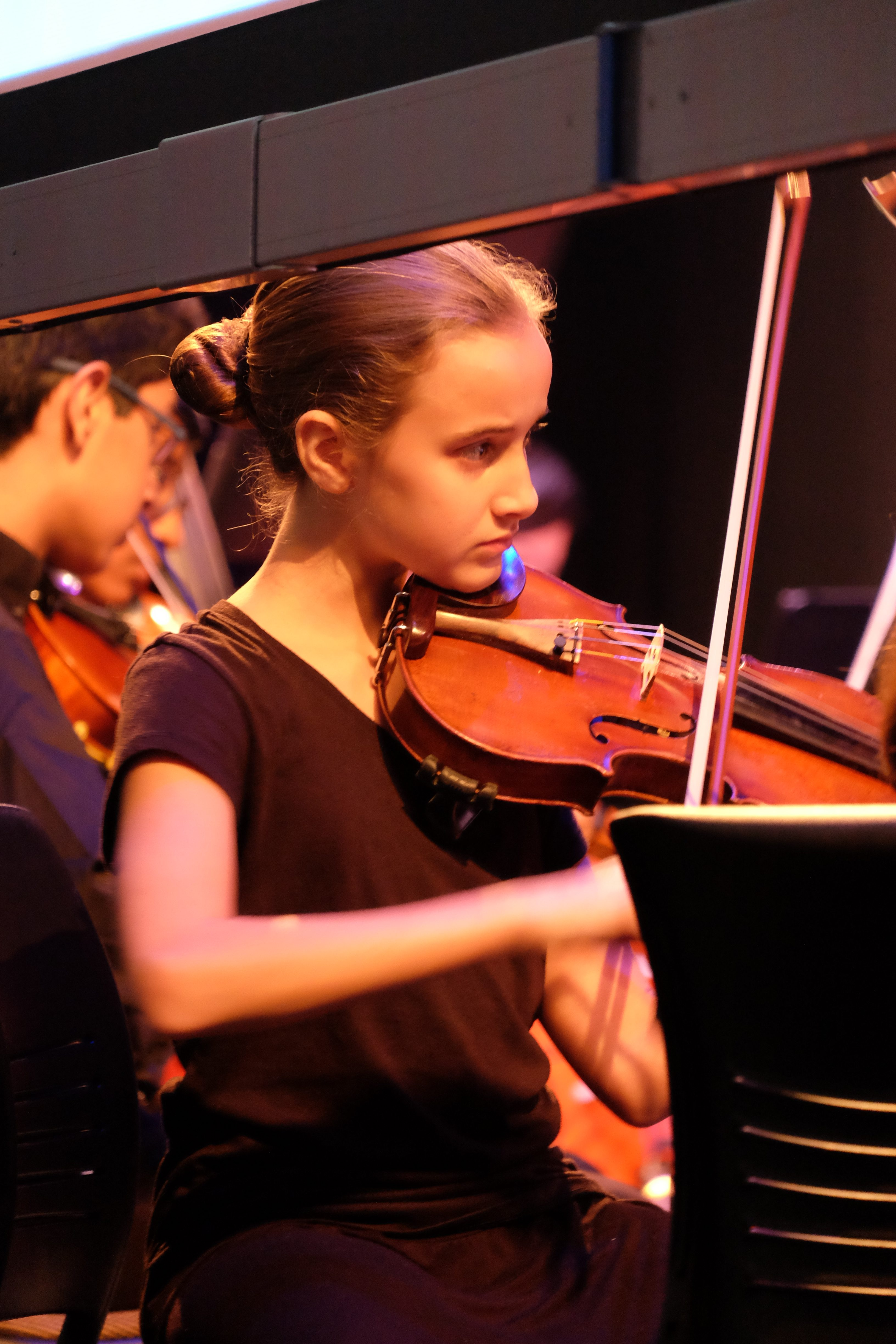 Close up of young violinist at string sinfonia concert