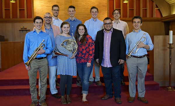 Photo of brass quintet posing with Triton Brass in a church