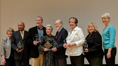 Dr. Partridge posing with all award recipients at BSA event
