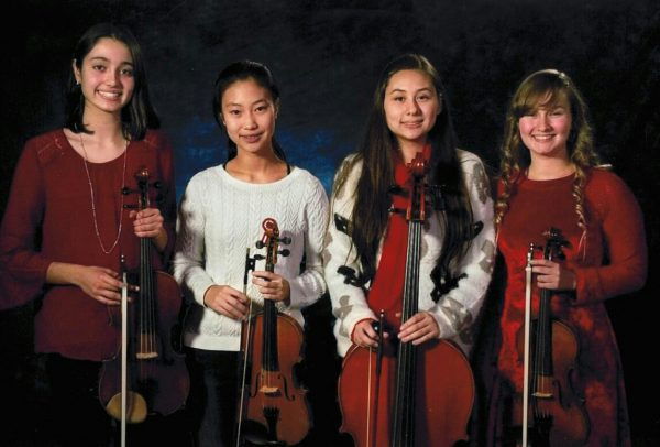 Posed photo of string quartet