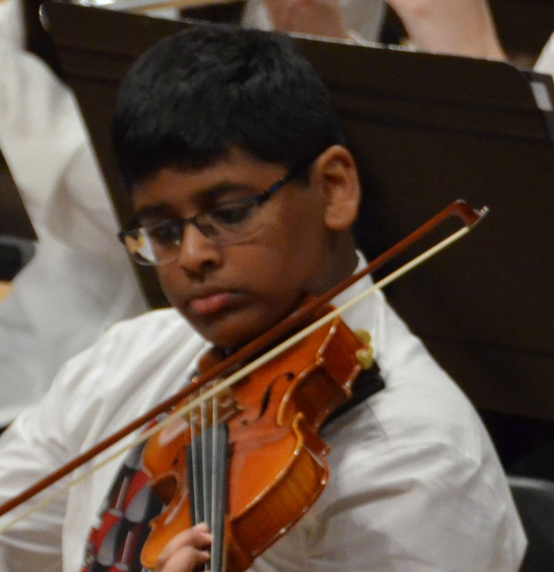 Photo of young violinist at the Triangle Youth Symphony concert