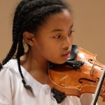 Photo of young violinist at Triangle Youth Orchestra concert