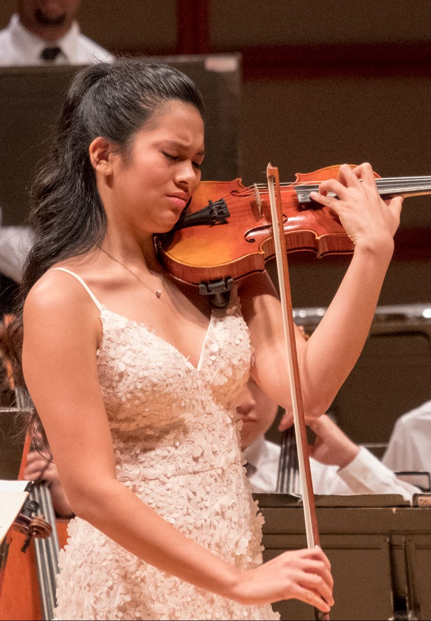 Photo of passionate solo violinist during philharmonic concert
