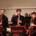 Photo of saxophonists during jazz band concert
