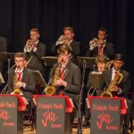 Photo of horn section at a jazz ensemble performance