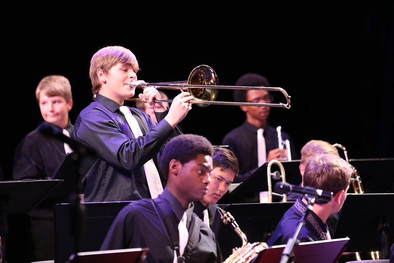 Photo of trombonist taking a solo at jazz orchestra concert