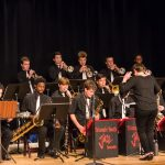 Photo of triangle youth jazz orchestra with director during concert