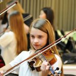 photo of violinist at string orchestra dress rehearsal