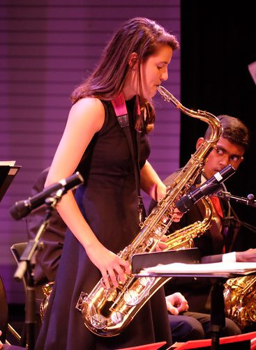 Photo of saxophonist taking a solo during jazz performance