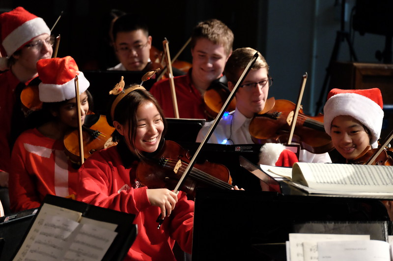 Musicians in the Triangle Youth Philharmonic wearing santa hats perform a holiday concert
