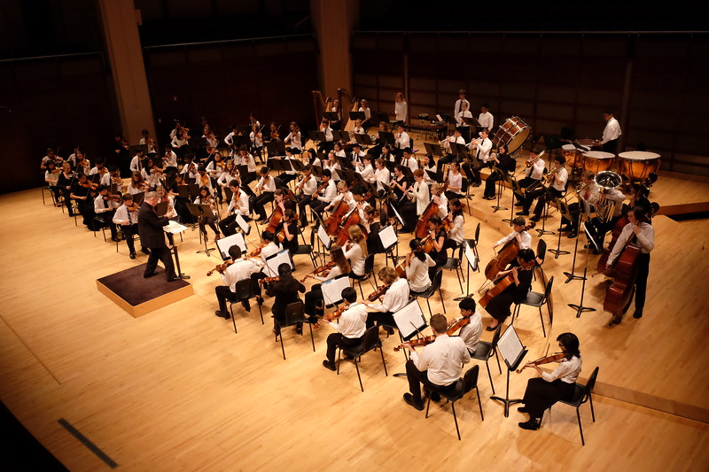 The entire Triangle Youth Philharmonic is shown on the stage of Meymandi Concert Hall