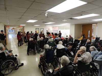 Holiday Ensemble Musicians perform for large group of senior citizens at Mayview Rehabilitation Center