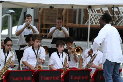 Triangle Youth Jazz Ensemble performing at Koka Booth Amphitheater. Kobie Watkins conducts.