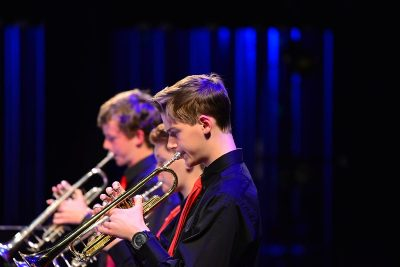 A row of trumpet players from one of the jazz bands performing during a concert