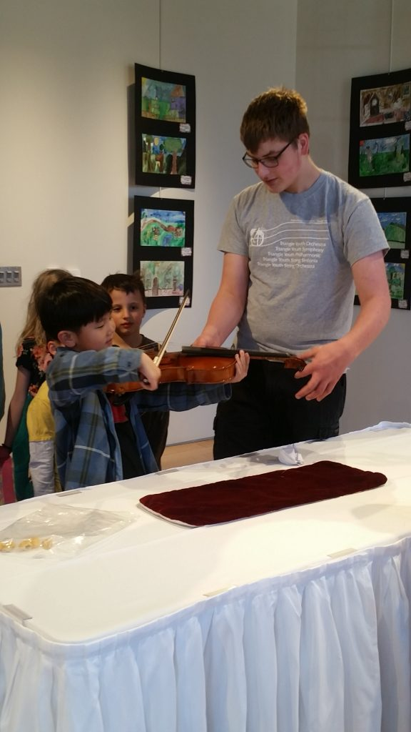 PA Musician helps child play viola