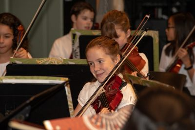 young musician plays violin in Triangle Youth String Orchestra