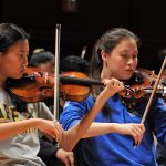Violinists perform in Triangle Youth Philharmonic