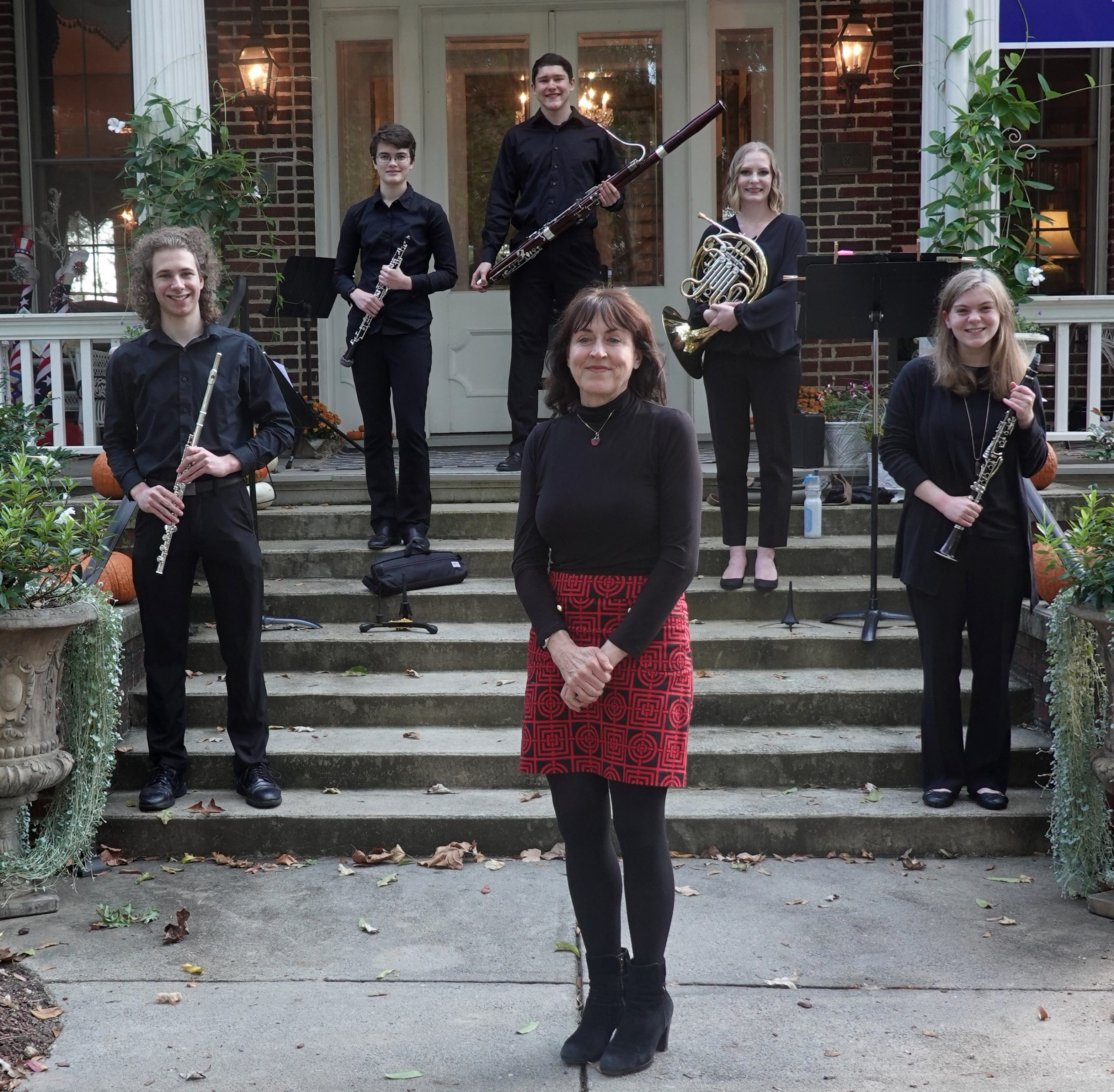 Image of TYP Wind Quintet and coach Mary Boone standing on porch