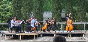 image of United Strings of Color performing alongside guest musicians